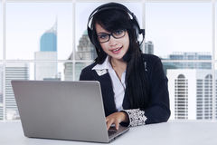 Female operator at workplace in the office Stock Image