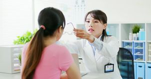 Female ophthalmologist and patient royalty free stock photography