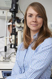 Female Optician Giving Male Client Eye Examination Royalty Free Stock Photo