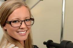 Female Optician Smiling. Beautiful female optician smiling in examination room stock photos