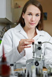 Female optician in workshop Royalty Free Stock Image
