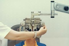 Female Optometrist Doing Sight Testing For Male Patient In Clinic royalty free stock image