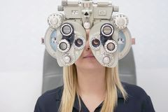 Female Optometrist Doing Sight Testing For female Patient In Clinic stock photography