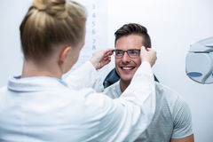 Female optometrist prescribing spectacles to patient Stock Photos