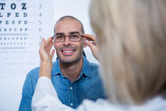 Female optometrist prescribing spectacles to patient Royalty Free Stock Photography