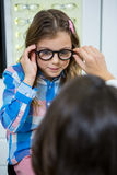 Female optometrist prescribing spectacles to young patient Royalty Free Stock Photo