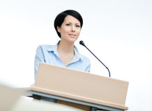 Female orator at the podium stock images