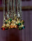 Female ornaments stylish. Beautiful female ornaments hanging in a store display background photograph stock photography