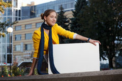 Female outdoors with blank board Royalty Free Stock Photography