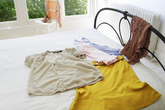 Female Outfit On Bed Royalty Free Stock Image