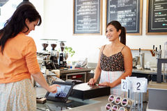 Female Owner Of Coffee Shop. Smiling stock images