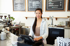 Female Owner Of Coffee Shop. Smiling To Camera royalty free stock photography