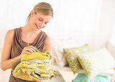 Female Owner Examining Sheets In Bedding Store Stock Photos