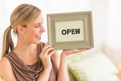 Female Owner Holding Open Sign In Bedding Store Royalty Free Stock Photos