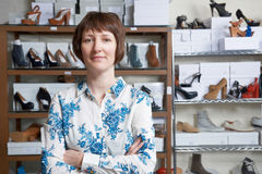 Female Owner Of Shoe Shop. Portrait Of Female Owner Of Shoe Shop Stock Photography