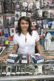 Female Owner Standing By Counter In Mobile Shop Royalty Free Stock Photography
