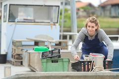 Female oyster picker on boat Stock Photos