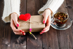 Female pack and give present wrapped craft paper Stock Image