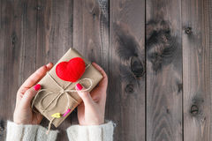Female pack and give present wrapped craft paper Stock Photos