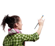 Female painter. Beautiful girl with paint brush on white background Stock Image