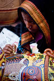 The female painter of bengal. Woman painting clay pot in local art fair in bengal, India Stock Photo