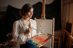 Female painter with color palette and brush stock photos