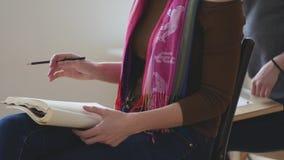 Female painter draws sketches in art studio stock video