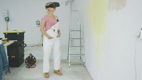 Female painter enjoying virtual reality headset stock footage
