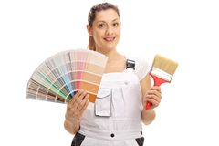 Female painter holding a color swatch and a brush. Isolated on white background stock photo