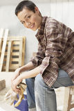 Female Painter Holding Gloves On Work Break Royalty Free Stock Images