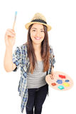 Female painter holding paintbrush Royalty Free Stock Photography