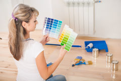 Female painter holding and see in color palette Stock Photo