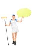 Female painter holding a speech bubble Stock Photo