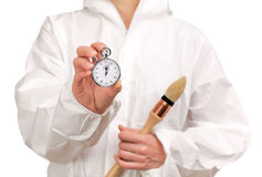 Female painter holding a stopwatch royalty free stock image