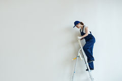 Female Painter on Stepladder Royalty Free Stock Photos