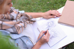 Female Painter Suggests Contours Drawing, Leads For Final Stage. Contemporary Artist Works on Facial Contour of Depicted on Portrait Unknown Girl, Draws Sketch Royalty Free Stock Photo