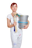 Painter with paint buckets. Female painter with two paint buckets and different brushes Royalty Free Stock Photos
