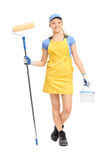 Female painter walking with a paint roller Royalty Free Stock Images