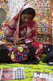 The female painter. Woman painting pattachitra in local art fair Royalty Free Stock Photo