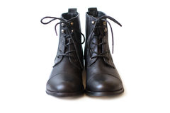 Female pair of black boots with shoelaces tied closeup. Female pair of black boots with shoelaces tied royalty free stock images