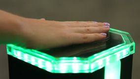 Female palm on innovative identification equipment, biometrics authentication. Stock footage stock video footage