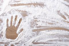 Female palm print on flour scattered Stock Photos