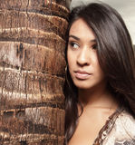 Female by a palm tree Stock Photos