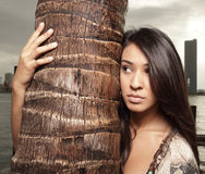 Female by a palm tree Royalty Free Stock Photography