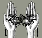 Female palms of hands with a decorative carnival Venetian mask Royalty Free Stock Photography
