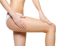 Female pampering skin on her legs Stock Image