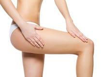 Female pampering skin on her legs Stock Image