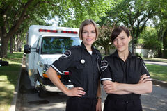 Female Paramedic with Ambulance Stock Images