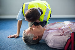 Female paramedic during cardiopulmonary resuscitation training Stock Photography