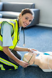 Female paramedic during cardiopulmonary resuscitation training Royalty Free Stock Photo